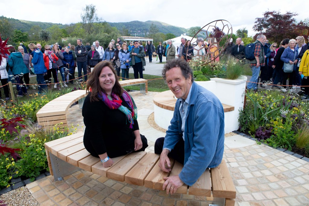 Photo of the designer, Julie Bellingham with Monty Don on the Redshift show garden.